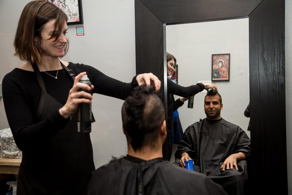 Lana Bowen, owner of Salana Hair Studio in Lower Nob Hill, styling Pedram Afshar's new mohawk at the free hair cuts event on Thursday, Feb. 5th, Photo by Zhenya Sokolova