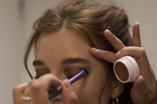 Avalon Petersen stands still as the make-up artist touches up her eyeshadow. Brenna Cruz/Xpress