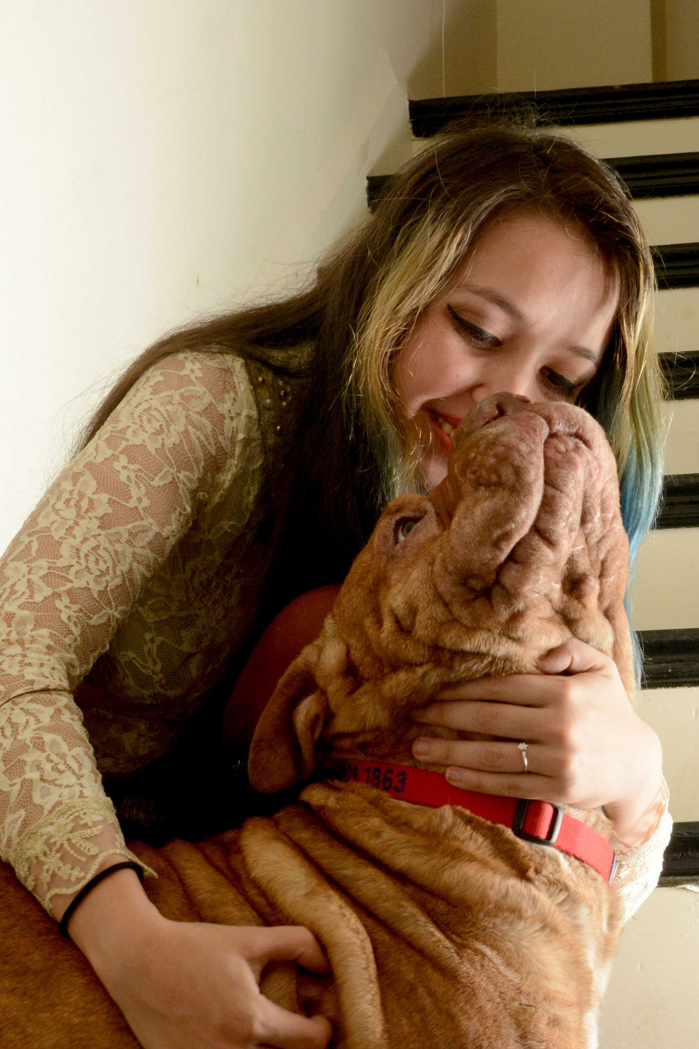 Pamela Ortiz plays with her dog, Zelda, in her San Francisco home. Photo by Aaron Levy-Wolins.