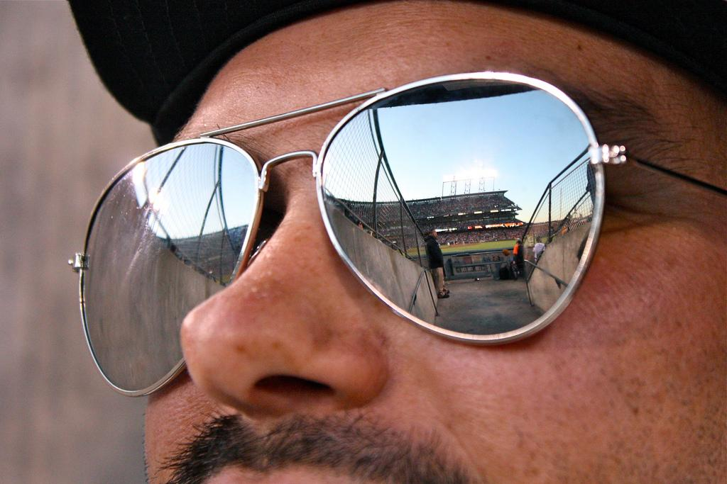 Joe Grill watches the Giants vs Rockies game on Tuesday April 9, 2013.