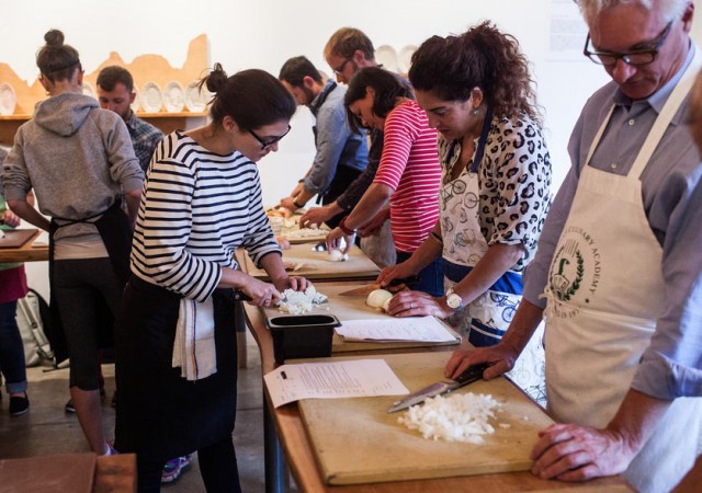 Michelle McKenzie, program director and chef at 18 Reasons, teaches an attendee to correctly chop an onion during a knife skills class at 18 Reasons Cafe in the Mission.