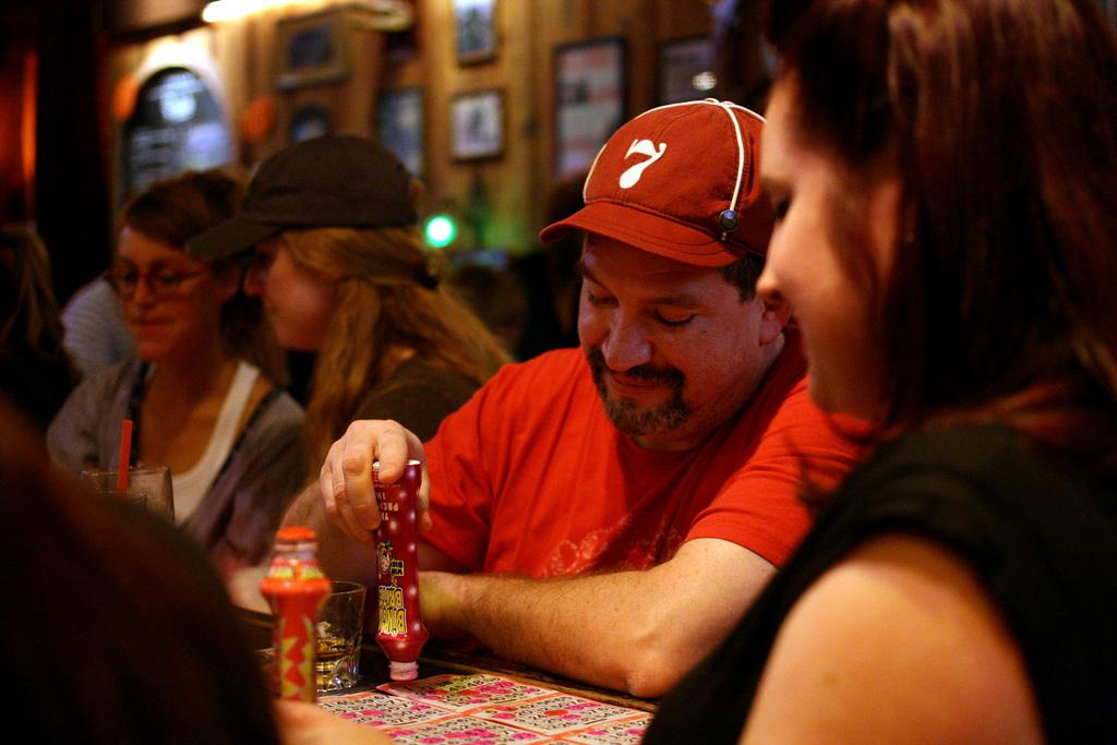 John Franco marks his bingo card after his number is called at The Riptide located at 3639 Taraval St. between 46th and 47th avenues, Saturday Sept. 10, 2013. The Riptide hosts bingo night every saturday night from 6 p.m. to 9 p.m. with a final round grand prize of a $50 bar tab.  Photo By Tony Santos / Xpress