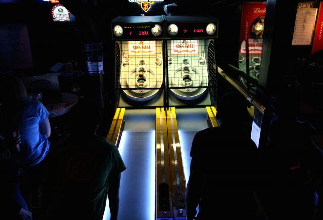 Myra Navarro (left), of Fighting Falangees Balls of Fury, and Chris Chang, of ASTRO Ballers, play each other during a skeeball match at Bar None, in San Francisco, Monday, Feb. 20th, 2014. Photo by Gavin McIntyre / Xpress