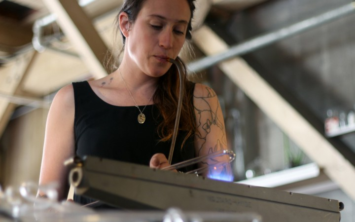 Neon Artist Meryl Pataky works on a glass tube that will be used for an upcoming piece. (Gavin McIntyre / Xpress Magazine)