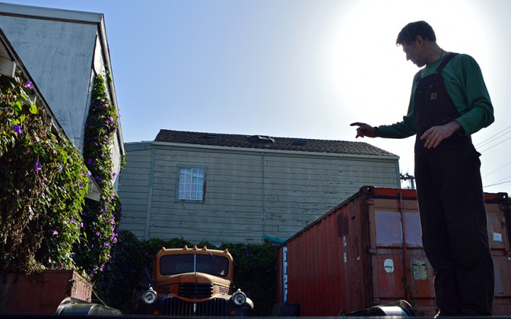 Future tiny house builder, Alain Despatie stands on his trailer where his tiny home will be built in West Oakland. (Katie Lewellyn)