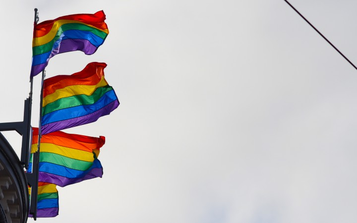Four pride flags fly high over the Castro neighborhood July, 26 2015. Peter Snarr/ Xpress