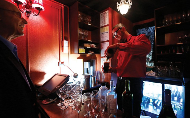 Jeremiah Rushing, bar tender at Old Skool Cafe, a faith-based violence prevention program that provides employment and restaurant skills to youth ages 16-22, pours beer for customers Saturday Nov. 14, 2015. Photo by Emma Chiang