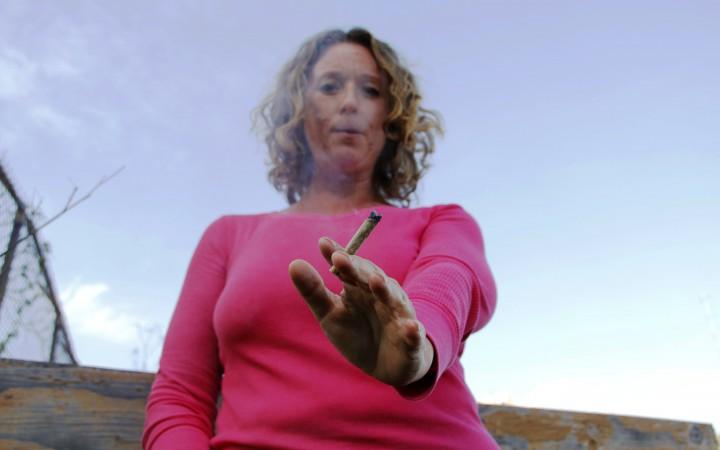 Amanda Reiman, a patient who uses Flow Kana cannabis poses for a portrait in San Francisco, Sat. Feb. 20. (Imani Miller/Xpress).