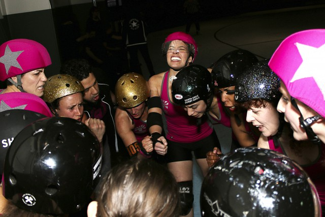 Berkeley Resistance derby team members celebrate their win after their bout with the Richmond Wrecking Belles at the Richmond Craneway Pavilion in Richmond, Calif. on Saturday, March 26, 2016.