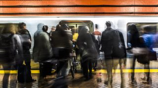 Passengers get on the BART during rush hour at Powell Station on Tuesday, Sept. 13, 2016.