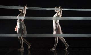 Kaneisee Collective's dancers walk in to the stage at the begining of the