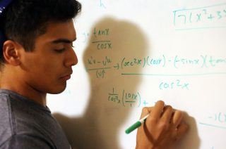 GSP Student Ivan Manriquez works on an equation for his calculus class in his dorm at the Towers dormitory on Tuesday, Oct.18, 2016. Manriquez hopes to gain a degree in astronomy from SFSU with the help of the Guardian Scholars program.