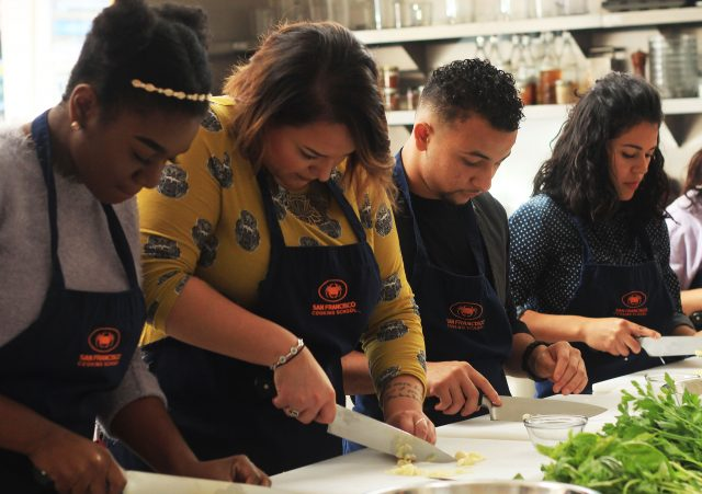 GSP+students+Zemaye+Jacobs+and+Joel+Martin-Dill++join+GSP+caseworker+Melanie+Ramirez-Carpio+during+a+cooking+class+at+the+San+Francisco+Cooking+School+on+Monday%2C+Oct.+10%2C+2016.+Recently%2C+the+program+added+a+few+new+events%2C+like+the+Cooking+Project+Event+to+create+student+bonding.
