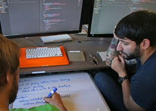 Hack Reactor students Daniel Shneyder (right) and Nick Lathen (left) work together to figure out a software issue at Hack Reactor in San Francisco, Calif. on Oct. 6, 2016. Hack Reactor is an intensive 12-week software programing course which boasts a 98 percent graduate hiring rate. (George Morin/Xpress)