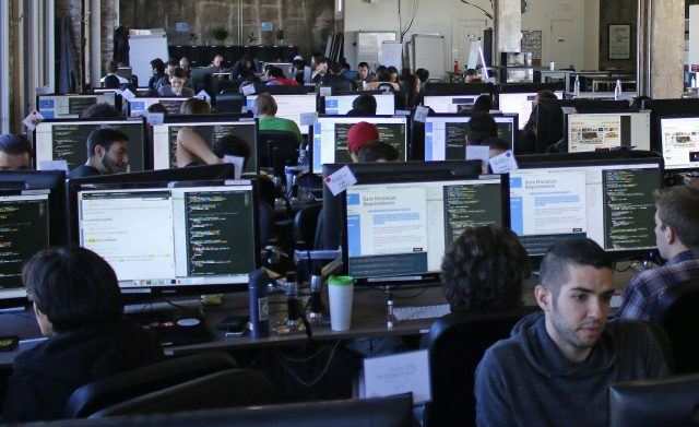 Hack Reactor students fill the eighth floor of Hack Reactor in San Francisco, Calif. on Oct. 6, 2016. Hack Reactor is an intensive 12-week software programing course which boasts a 98 percent graduate hiring rate. (George Morin/Xpress)