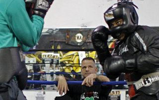 Jimmy Ford watches as two fighters spar at Fire in the Ring Boxing Gym on Wednesday October 5, 2016. Fire in the Ring which was founded by Jimmy Ford provides a free after school program for the youth in order to provide a safe environment. Connor Hunt // Xpress Magazine