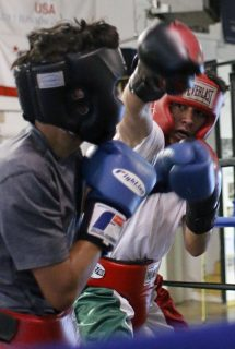 Saul Soto, 16, spars with Miguel Rosas, 11, at Fire in The Ring Boxing Gym. Connor Hunt // Xpress Magazine