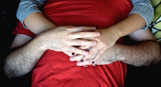 Yoni Alkan and Rosalie Del Toro demonstrate different ways to incorporate hands into cuddling sessions on Saturday, November 5, 2016. Alkan is a professional cuddler who offers non-sexual and therapeutic sessions at his private cuddle space in the Richmond District. (Eric Chan / Xpress)