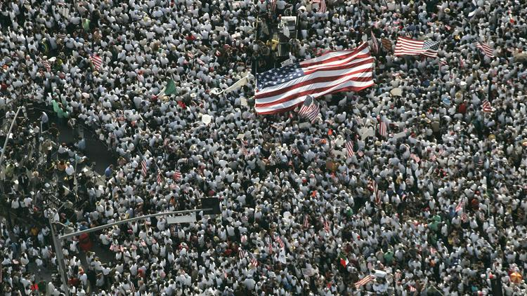 Protesters march down Wilshire Blvd. during an immigration demonstration on Monday, May 1, 2006. (Photo courtesy of Los Angeles Times)