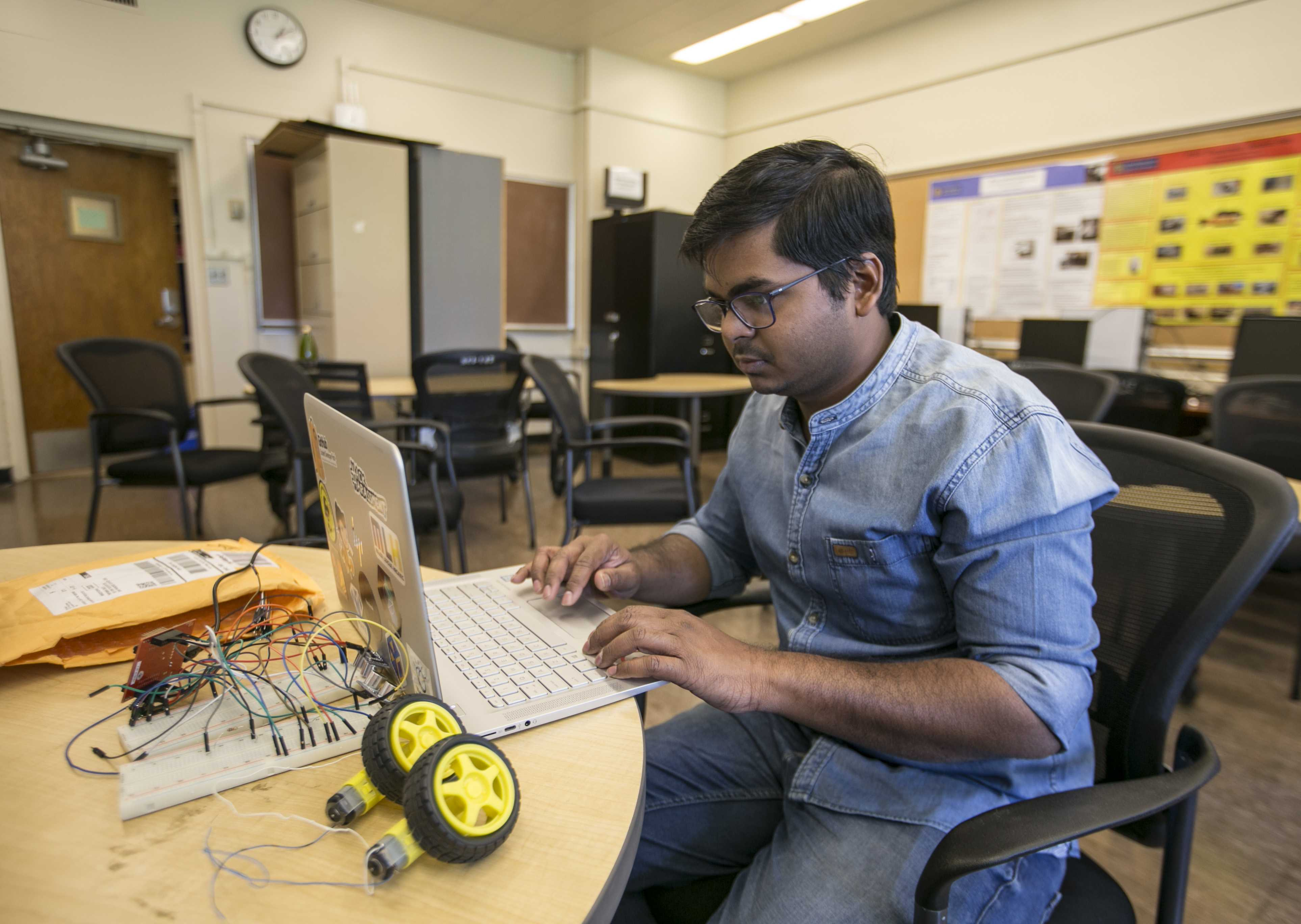 Sairoop a SF State embedded systems major utilizing lab hours in the science department on campus to build a automatic robotic vacuum cleaner. Using four ultra sonic senors and five motors all made from scratch, his aim for the project is to be economical and efficient. Apr 18, 2017. ( Xpress Mag Ryan Zaragoza).
