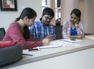 Priyanka Salvi (left) Sairoop Dasaraju (center) Bhavana Yadav (right) collaborate on an Industrial finances assignement at J. Paul Leonard Library at SF State on Apr. 16, 2017. (Ryan Zaragoza / Xpress).
