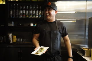 Chef Quinten Frye standing with finished cricket tostadas at the Mosto Bar on Valencia Street in San Francisco, Calif. on Oct 9, 2017. (Diego Aguilar/Golden Gate Xpress)