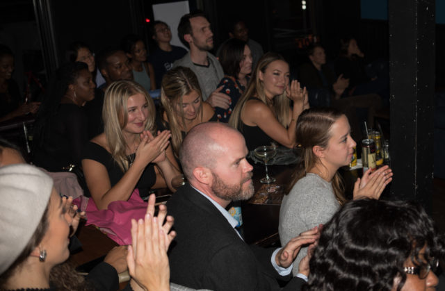 People applaud as comedians perform at Trademark & Copyright for the HellaFunny Fridays show in San Francisco on Friday, Sept. 28, 2018.