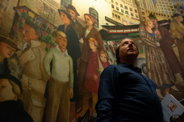 John Golinger chair and founder of protect Coit Tower looks up at the murals in the second floor inside the tower in San Francisco. People don't get easy access to the second floor due to the walls not having any barriers to protect them from damages. on Monday, Oct. 29, 2018. (David Rodriguez/Xpress Magazine)