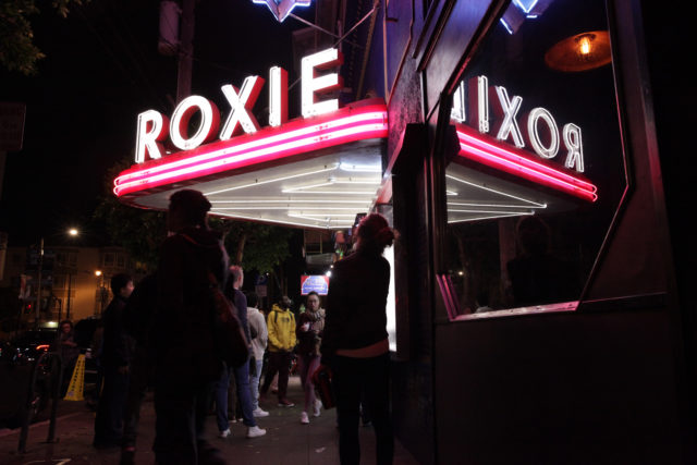People walk past the Roxie Theater, in the Mission District, as the SF Latino Film Fest came to a close on Sunday, in San Francisco, on September 30, 2018. (Janett Perez/Xpress)