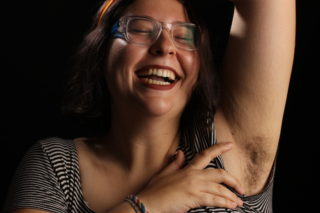 Mel Green, 19, displays her armpit hair. She first shaved her legs in elementary school to imitate her sister. As she grew older, she started pushing boundaries on femininity and a large part of that was putting down the razor. (Francisca Velasco/Xpress)