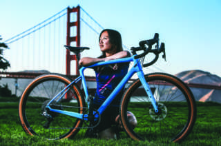 Alice Thiu poses for a portrait with her custom-made bike from her bicycle company THESIS at Crissy Field in San Francisco, Calif. on Friday, October 12th, 2018. (Mira Laing)