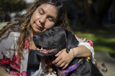 Daisy Soto cuddles her service dog, Miles in San Francisco, Calif. Feb. 26, 2020. (Emily Curiel / Xpress Magazine)