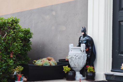 Batman watches over the front door.