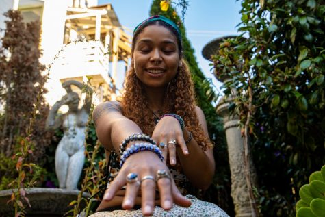 Gaia the Empress shows off her jewelry, which carries spiritual significance, in the garden of Sword and Rose, after purchasing new gemstones on October 14, 2020.
