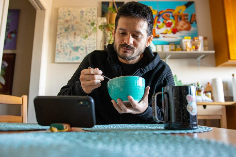 He starts off his day with a bowl of Maple Clusters with Frosted Wheaties watching Sweatdreams twitch stream, in Daly City, Calif. (Amalia Diaz / Xpress Magazine)