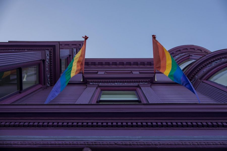 Pride flags hang above a window at the SFLGBT Center in the Castro District. (Emily Curiel / Xpress Magazine)