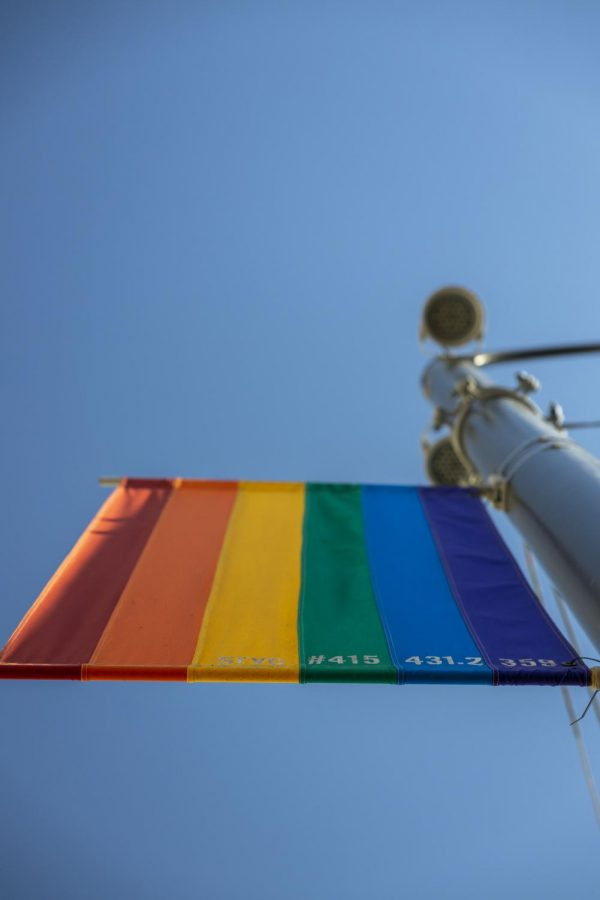 A rainbow light banner sways back and forth in the wind in the Castro District. (Emily Curiel / Xpress Magazine)