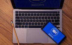 A laptop and phone sit showing the Zoom logo on Wednesday, September 8, 2021. . (Elizabeth Agazaryan / Xpress Magazine)