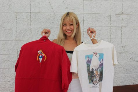 Claudine Mallare holds up a secondhand jacket with Sailor Moon on the back and a second-hand t-shirt in South San Francisco, Calif., on Oct. 7, 2021. (Paris Galarza / Xpress Magazine)